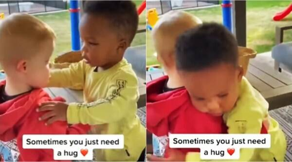 boys hugging to comfort, Sometimes you just need a hug, toddlers friend hug, different ethnicity boy hug video, viral videos, indian express
