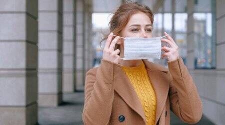 driver license errors, driver license with face mask, woman get license with face mask photo, California DMV face mask mistake, California woman diver's license, California woman diver's license photo, viral news, odd news, indian express
