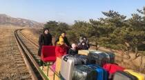 Russian diplomats push their way home with handcar out of North Korea