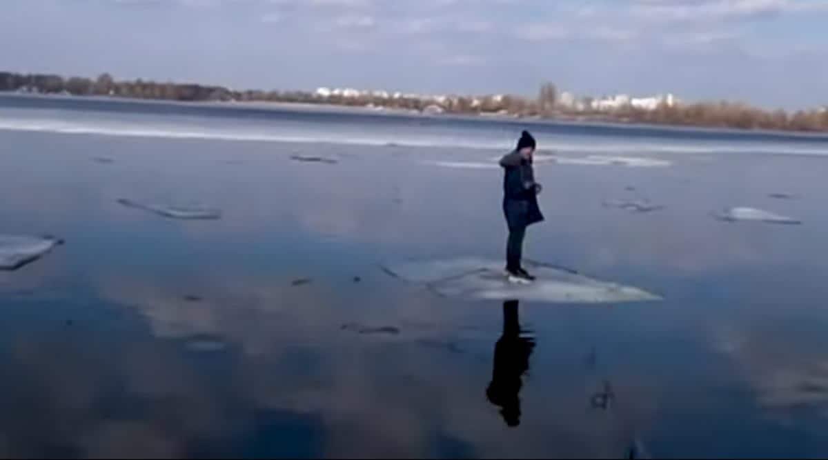 Ukraine , Ukraine fisherman, fisherman fishing boy rescue, boy standing on ice sheet rescused, fisherman, trending, viral video, good news, indian express, indian express news