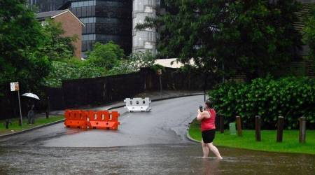 Heavy rain forces parts of Sydney to evacuate, downpour to continue