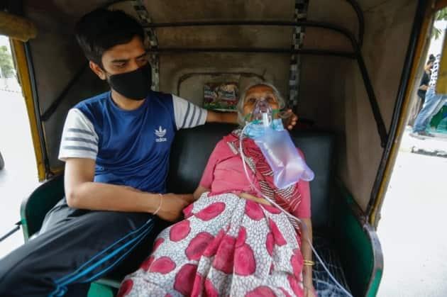 India covid 19 cases, India Coronavirus cases, India oxygen shortage, oxygen cylinder supply, Indian Express news