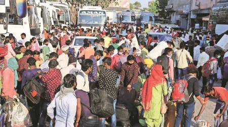 migrant workers, migrant workers from Punjab to UP, migrant workers Punjab to Bihar, migrant workers bus challan, migrant crisis in india, india news, indian express