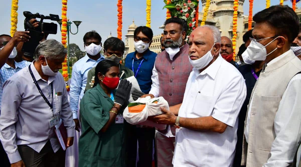 Karnataka CM Yediyurappa distributes new uniforms, protective equipments to sanitation workers on Ambedkar Jayanti