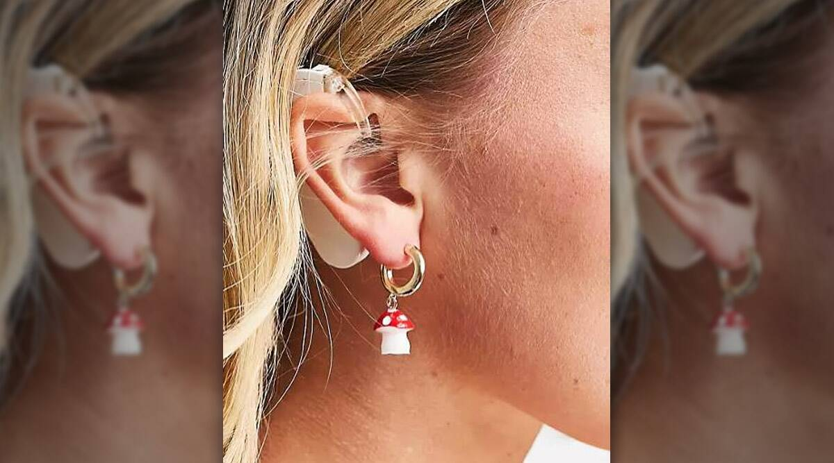 earring ad, model with hearing aid
