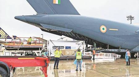 IAF, Navy, Oxygen, Covid-19 India Second Wave, India oxygen from Singapore, Singapore news, Singapore india relations, rajnath singh, india news, indian express