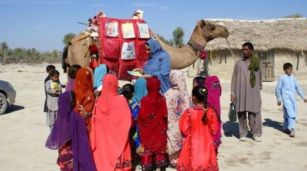 Roshan camel, library Pakistan, camel library rural Pakistan, Covid-19, Coronavirus, homeschooling, Trending news, Indian Express news