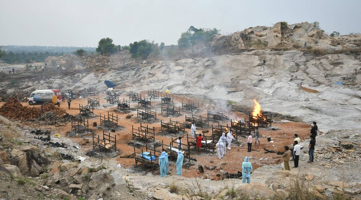 With Bengaluru crematoriums running out of space, pyres burn at granite quarry outside city