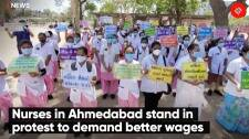 Nurses in Ahmedabad stand in protest to demand better wages