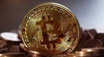 Bitcoin hits three-month low, then rallies, on Musk tweets