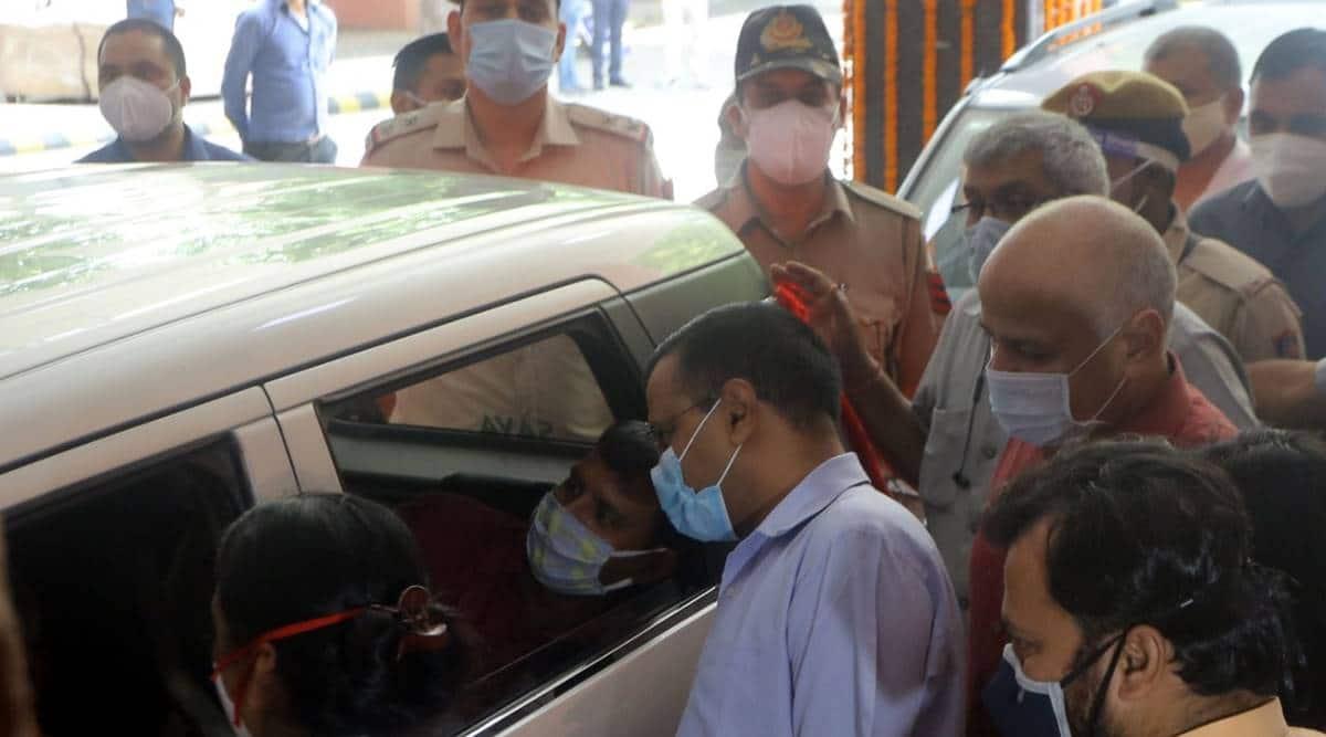 Delhi covid, delhi vaccinations, delhi covid vaccine, delhi vaccine slots 18-44, Delhi 18-44 vaccination cost, Drive-through shots, Delhi vaccinations, Arvind kejriwal, Satyender Jain, Manish Sisodia, Delhi Drive-through shot centres, Indian express