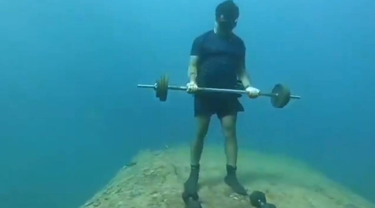 fitness, fitness and pandemic, how to stay fit in a pandemic, puducherry man underwater fitness, viral video puducherry man underwater, indianexpress.com, indianexpress,
