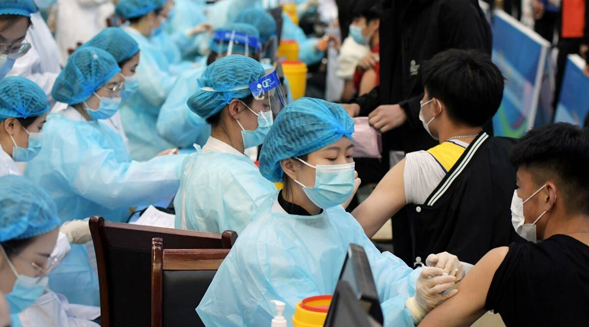China, Wuhan, China covid outbreak, Covid-19 China, China covid news, Covid-19 in China, China coronavirus latest news, coronavirus latest news china, CCP, Nanjing airport outbreak, Beijing, Indian Express News