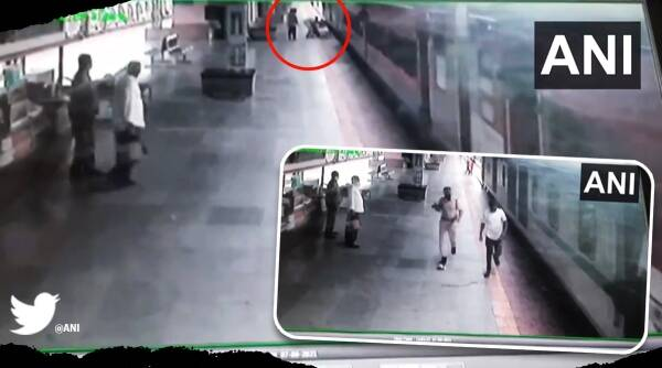 RFP personnel, Mumbai, Man saved from falling under moving train viral video Trending news, Indian Express news