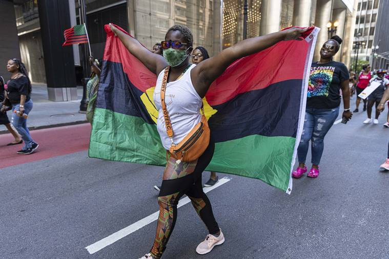Cheers and quiet reflection as US crowds mark Juneteenth