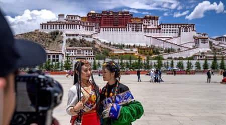 Tibet tourism boom, tourism boom in Tibet, AP tourism boom in Tibet, Associated Press, tourism pressures historic sites, historic sites in Tibet, fragile environment in Tibet, indianexpress.com
