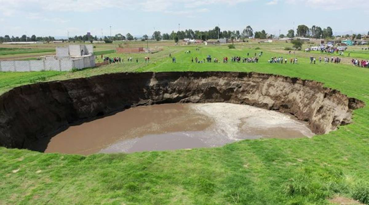 Massive sinkhole appears in Mexico field, threatens to swallow house