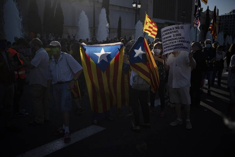 Catalans jeer Spanish king amid efforts to ease tensions