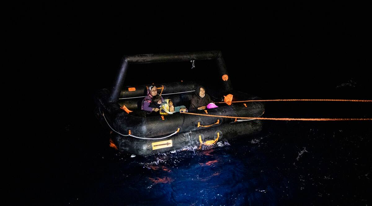 Aghan migrants are rescued by the Turkish Coast Guard near Dikili, Turkey in the Aegean Sea, July 2, 2021. (Ivor Prickett/The New York Times)