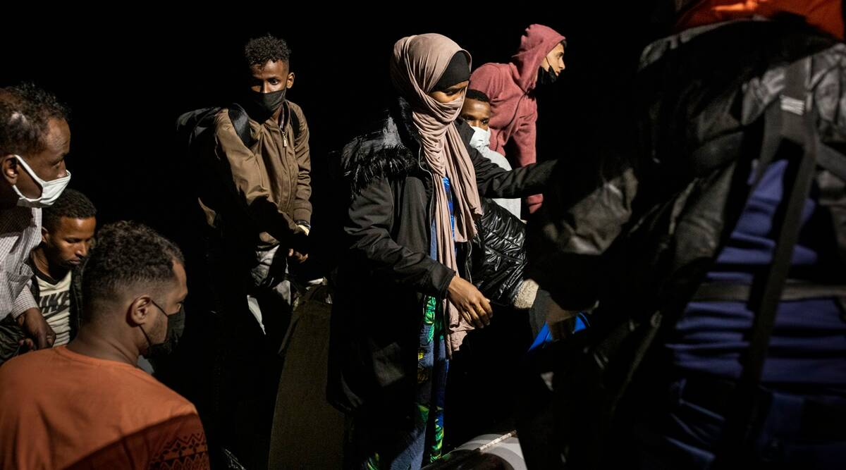 Aghan migrants are rescued by the Turkish Coast Guard near Dikili, Turkey in the Aegean Sea, July 6, 2021. (Ivor Prickett/The New York Times)