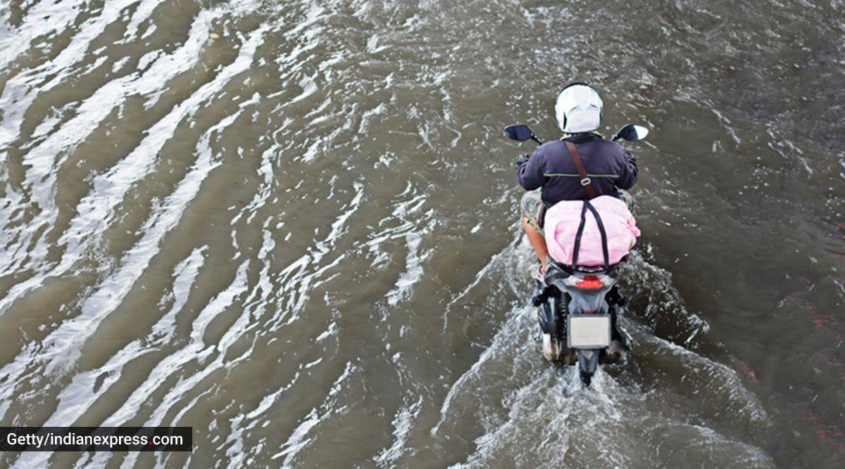 waterlogged roads, waterlogged streets, waterlogging in India, how to drive on waterlogged roads, how to drive a two wheeler on waterlogged roads, road safety for two wheelers, monsoon safety tips for two wheelers, indian express news