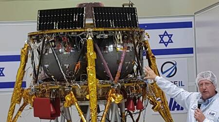 In this July 10, 2018 file photo, Opher Doron, general manager of Israel Aerospace Industries' space division, speaks beside the SpaceIL lunar module, during a press tour of their facility near Tel Aviv, Israel.