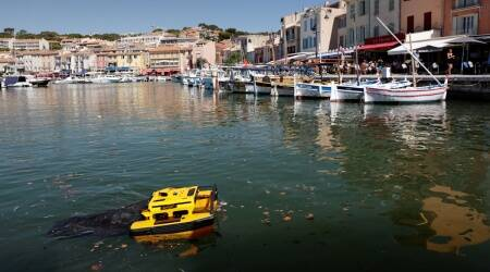 The Jellyfish, a little catamaran operated by remote control, which is capable to clean water by collecting rubbish on the water's surface is seen at work in the port of Cassis, southern France.