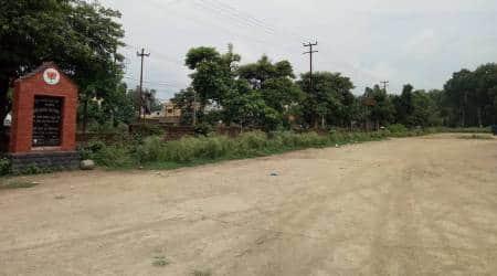 Uttarakhand land use laws, Uttarakhand land laws, Uttarakhand BJP HQ, Uttarakhand BJP headquarter dehradun, Uttarakhand CM Pushkar Singh Dhami, Indian express