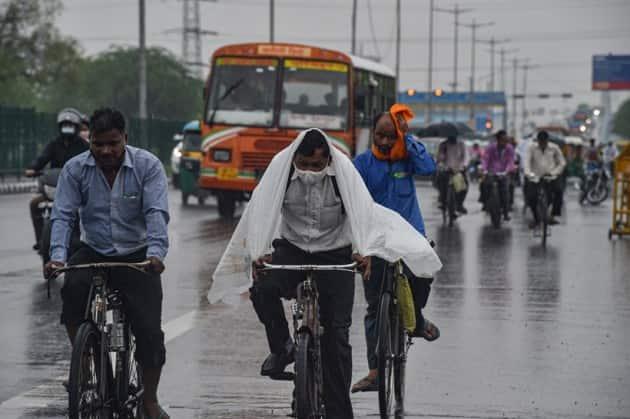 delhi monsoon, delhi rainfall, delhi monsoon pictures, delhi rain pictures, delhi photos, delhi rainfall, imd delhi rains, delhi monsoon delayed photos, delhi news, delhi latest news, delhi weather, delhi weather photos