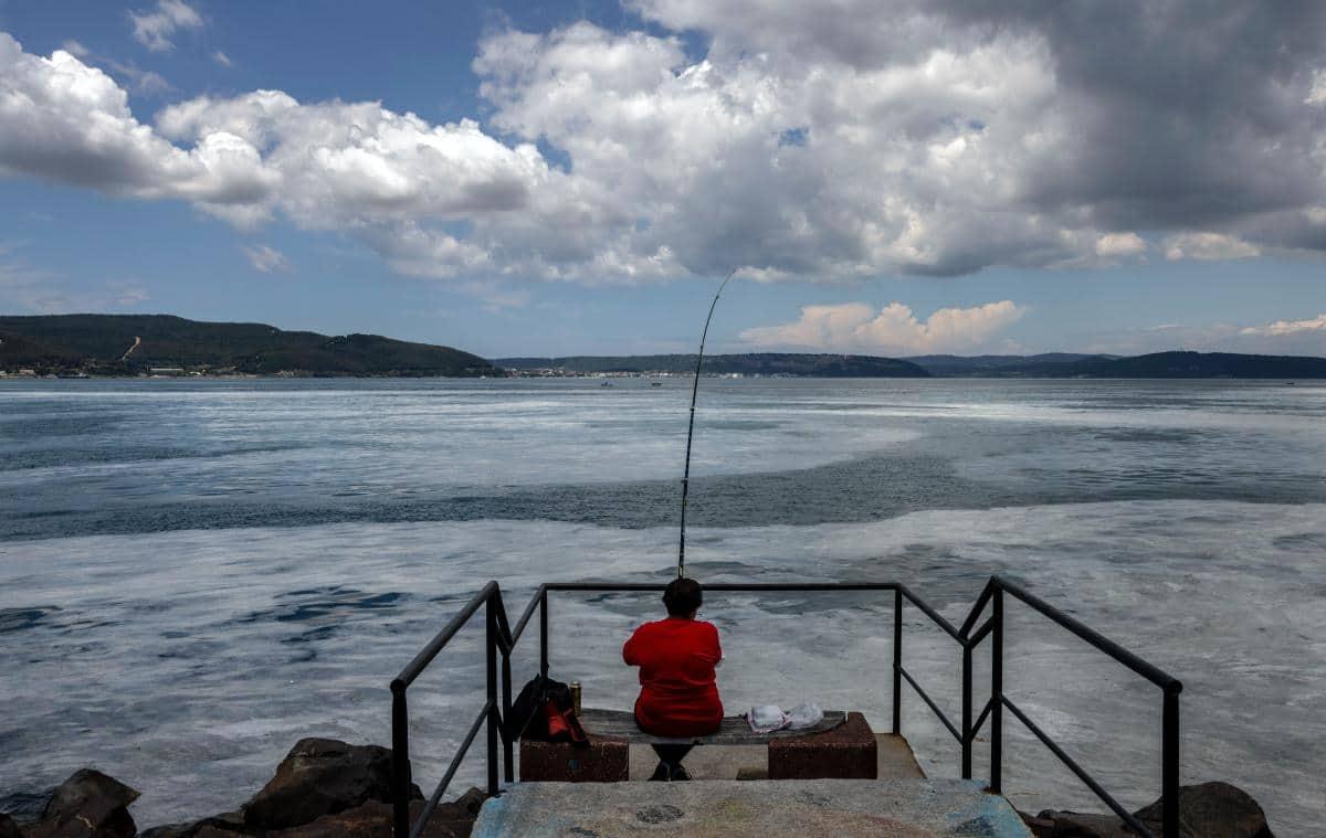 Man fishing in the waters of Sea of Marmara