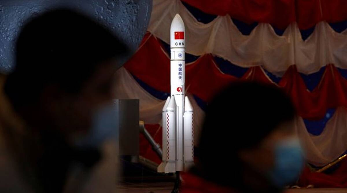 A model of the Long March-5 Y5 rocket from China's lunar exploration program Chang'e-5 Mission is displayed at an exhibition inside the National Museum in Beijing, China March 3, 2021.