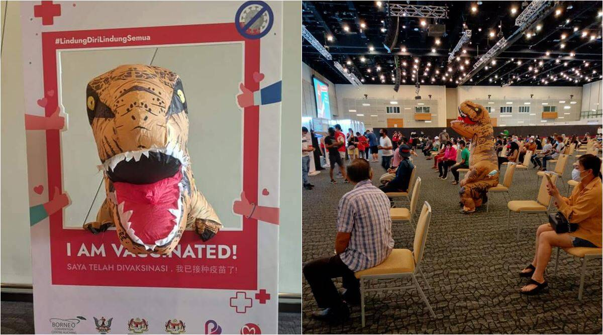 malaysia man dinosaur suit vaccination, dinosaur gets vaccinated, vaccination odd outfits, covid vaccine, viral news, funny news, indian express