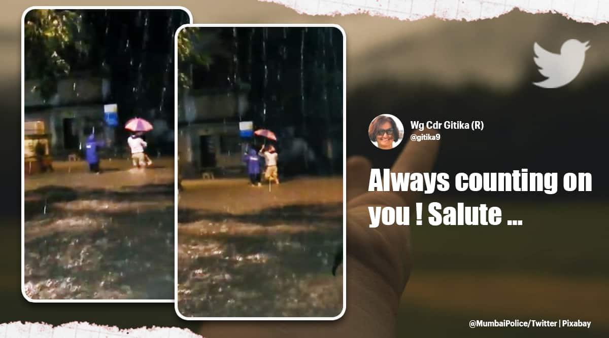 mumbai cop, mumbai rains, mumbai rain forecast, mumbai policeman saves father daughter viral video, trending, indian express, indian express news
