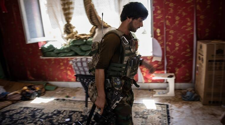 An Afghan commando at a frontline position inside a home in Kunduz, Afghanistan, July 6, 2021. How the country, and its military and police got to this point, can be traced to a slew of issues over the past two decades. (Jim Huylebroek/The New York Times)