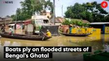 Boats ply on flooded streets of Bengal's Ghatal