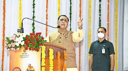 Gujarat Chief Minister Vijay Rupani, who kicked off day six of the nine-day-long five-year celebrations of the state government with the Rojgar Divas in Surat on FGujarat Congress, employment gujarat Gujarat government, former Prime Minister, Jawaharlal Nehru, Gujarat CM, Vijay rupani, Indian express news, indian express