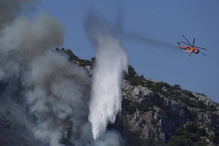 Wildfires rampage in Greek forests, cut large island in half