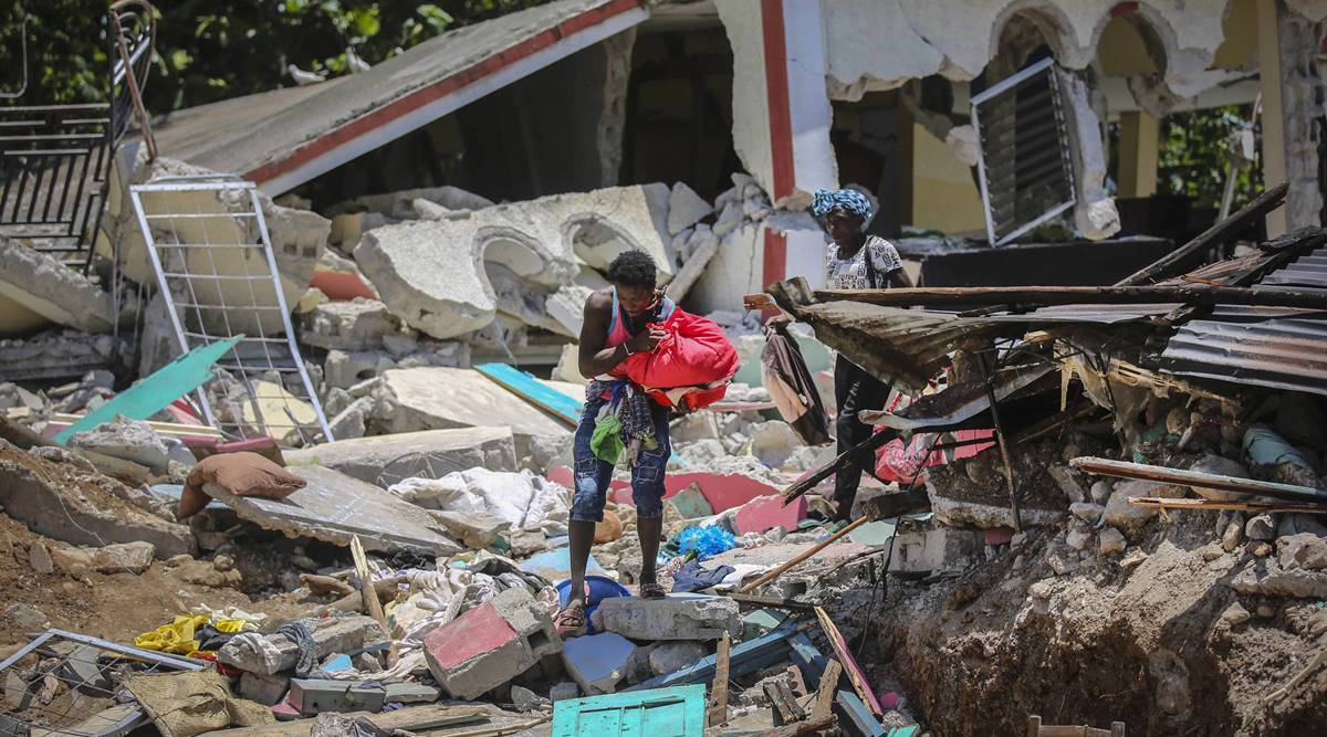 A mountain village looks for survivors, waits for help after Haiti's earthquake