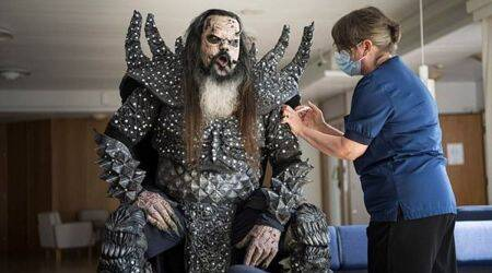 Eurovision winner Lordi Covid vaccine, Lordi vaccination viral picture, Lordi costume viral picture, twitter reactions, indian express, indian express news