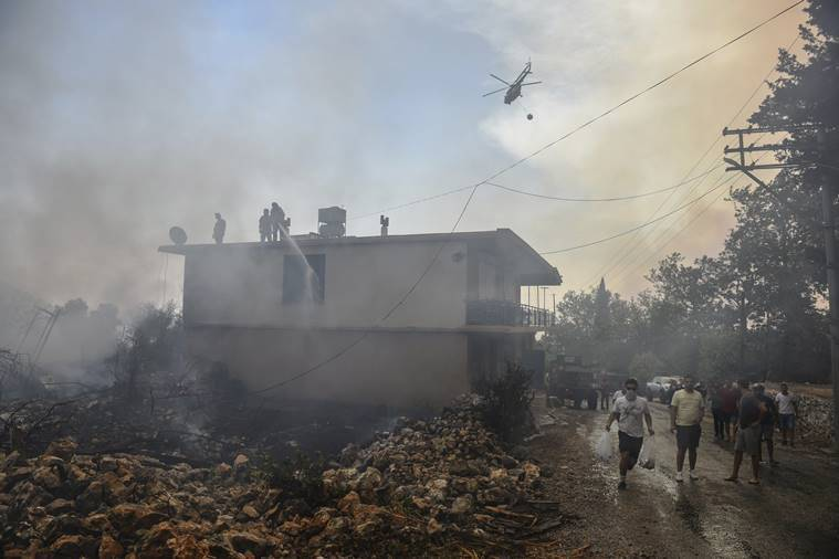 Tourists, villagers flee as wildfires ravage Turkish resorts