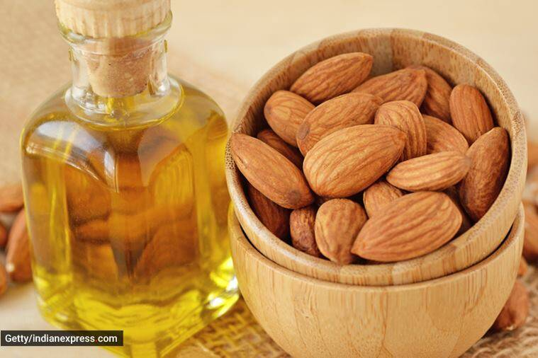 hair oil, hair care, hair care at home, different types of hair oils, hair oil benefits, coconut hair oil, almond hair oil, argan hair oil, oiling of hair and hair care, indian express news