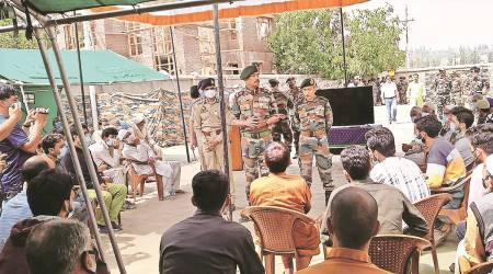 Top Army, police officers meet families of active Kashmir militants