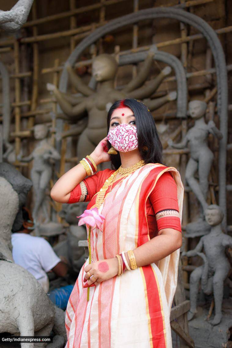 Covid-19, Covid-19 pandemic, Covid-19 and festivals, Navratri celebrations in pandemic, Durga puja celebrations in pandemic, safe Covid-19 measures, Covid-19 protocols, how to safely celebrate festivals, Covid-19 infection, Covid-19 risk, indian express news