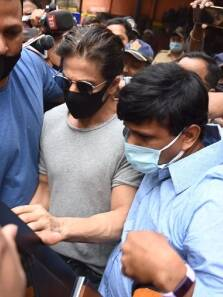 Shah Rukh Khan meets son Aryan, greets media with folded hands